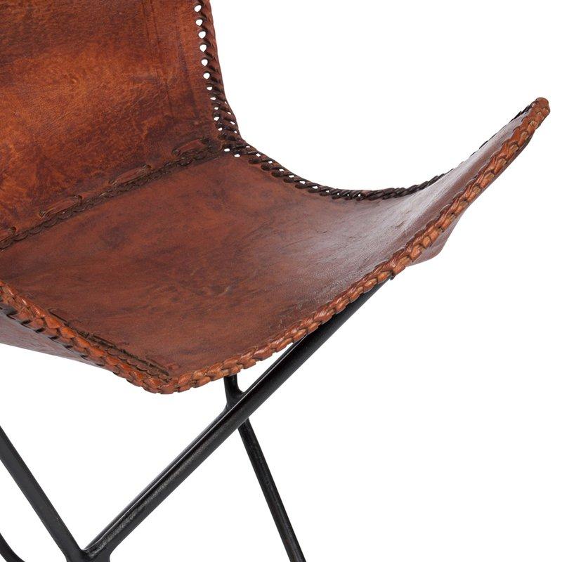 Fauteuil vintage en fer et cuir vieilli coloris marron